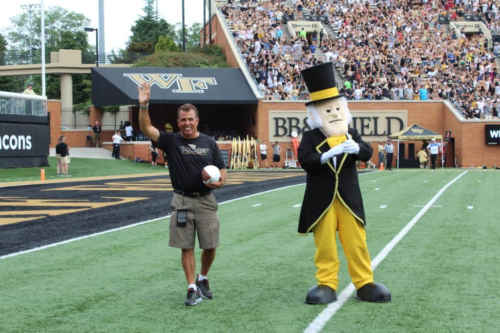 Clean Transportation Director Rick Sapienza accepting game ball from Wake Forest's mascot